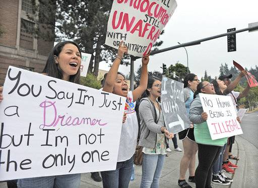 Students and supporters gather Tuesday evening, Sept. 5, 2017, at the Skagit County Courthouse to protest President Donald Trump's decision to end the Deferred Action for Childhood Arrivals (DACA) program. This was the second of two rallies at the courthouse in Mount Vernon protesting the DACA decision. (Scott Terrell/Skagit Valley Herald via AP)