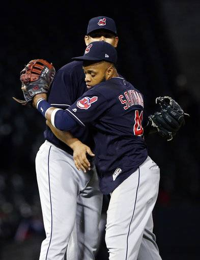 Cleveland Indians' Carlos Santana, right, celebrates with starting pitcher Carlos Carrasco after the Indians defeated the Chicago White Sox 5-1 in a baseball game Wednesday, Sept. 6, 2017, in Chicago. (AP Photo/Nam Y. Huh)