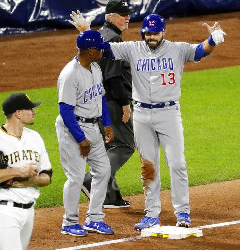 Chicago Cubs' Alex Avila (13) celebrates with coach Gary Jones, center, as he stands on third base after driving in the Cubs' only run with a triple off Pittsburgh Pirates relief pitcher Daniel Hudson, left, in the ninth inning of a baseball game in Pittsburgh, Wednesday, Sept. 6, 2017. The Cubs won 1-0. (AP Photo/Gene J. Puskar)
