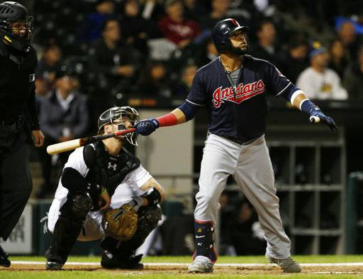 Cleveland Indians' Carlos Santana watches after hitting a two-run home run against the Chicago White Sox during the eighth inning of a baseball game Wednesday, Sept. 6, 2017, in Chicago. (AP Photo/Nam Y. Huh)
