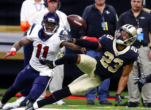 FILE - In this Aug. 26, 2017, file photo, New Orleans Saints cornerback Marshon Lattimore (23) breaks up a pass intended for Houston Texans wide receiver Jaelen Strong (11) during a preseason NFL football game in New Orleans. Lattimore figures the Saints brought him in specifically to improve a pass defense that allowed 273.8 yards per game _ right away, ideally. So he's not making any public pleas for patience with his adjustment to the NFL. If anything, he sounds like he doesn't believe he needs one. (AP Photo/Butch Dill, File)