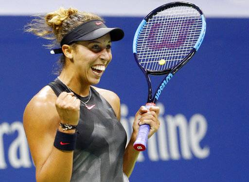 Madison Keys, of the United States, reacts after defeating Kaia Kanepi, of Estonia, in a quarterfinal match against at the U.S. Open tennis tournament in New York, Wednesday, Sept. 6, 2017. (AP Photo/Kathy Willens)