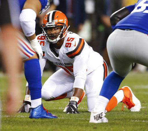 "FILE - In this Aug. 21, 2017, file photo, Cleveland Browns defensive end Myles Garrett (95) plays against the New York Giants during the first half of an NFL preseason football game,in Cleveland. As he prepares for his NFL debut, Browns rookie Myles Garrett says he's viewing Steelers quarterback Ben Roethlisberger as ""just another guy.� The top overall pick isn't backing down from his comment after the draft that he plans to sack Big Ben when Cleveland opens the regular season on Sunday against the Pittsburgh Steelers. (AP Photo/Ron Schwane, File)"