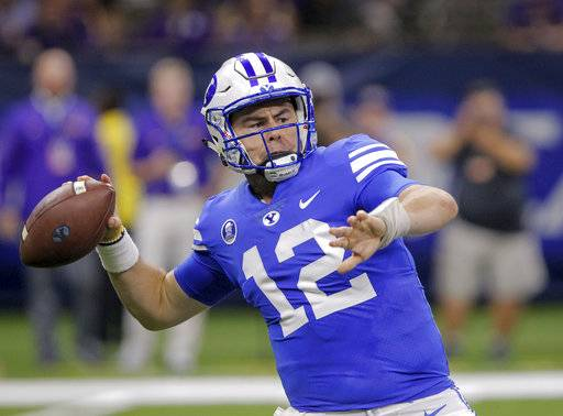 FILE - In this Saturday, Sept. 2, 2017, file photo, BYU quarterback Tanner Mangum (12) passes against LSU in the first half of an NCAA college football game in New Orleans. BYU coach Kalani Sitake didn't hesitate to that say a change is needed on the offensive side of the ball after the Cougars had one of the worst outings in recent history last weekend. (AP Photo/Scott Threlkeld, File)