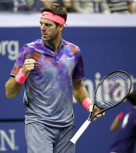 Juan Martin del Potro, of Argentina, reacts after winning a game against Roger Federer, of Switzerland, during the quarterfinals of the U.S. Open tennis tournament, Wednesday, Sept. 6, 2017, in New York. (AP Photo/Julio Cortez)