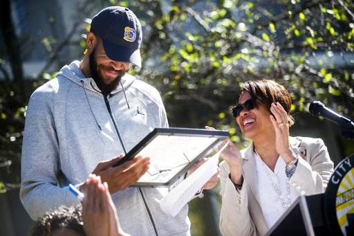 Flint Mayor Karen Weaver proclaims today JaVale McGee Day and gives a copy of the proclamation to Golden State Warriors center JaVale McGee, a Flint native and NBA champion who brought home the Larry O'Brien NBA Championship Trophy, on a homecoming tour Wednesday, Sept. 6, 2017 in Flint, Mich. (Jake May /The Flint Journal-MLive.com via AP)