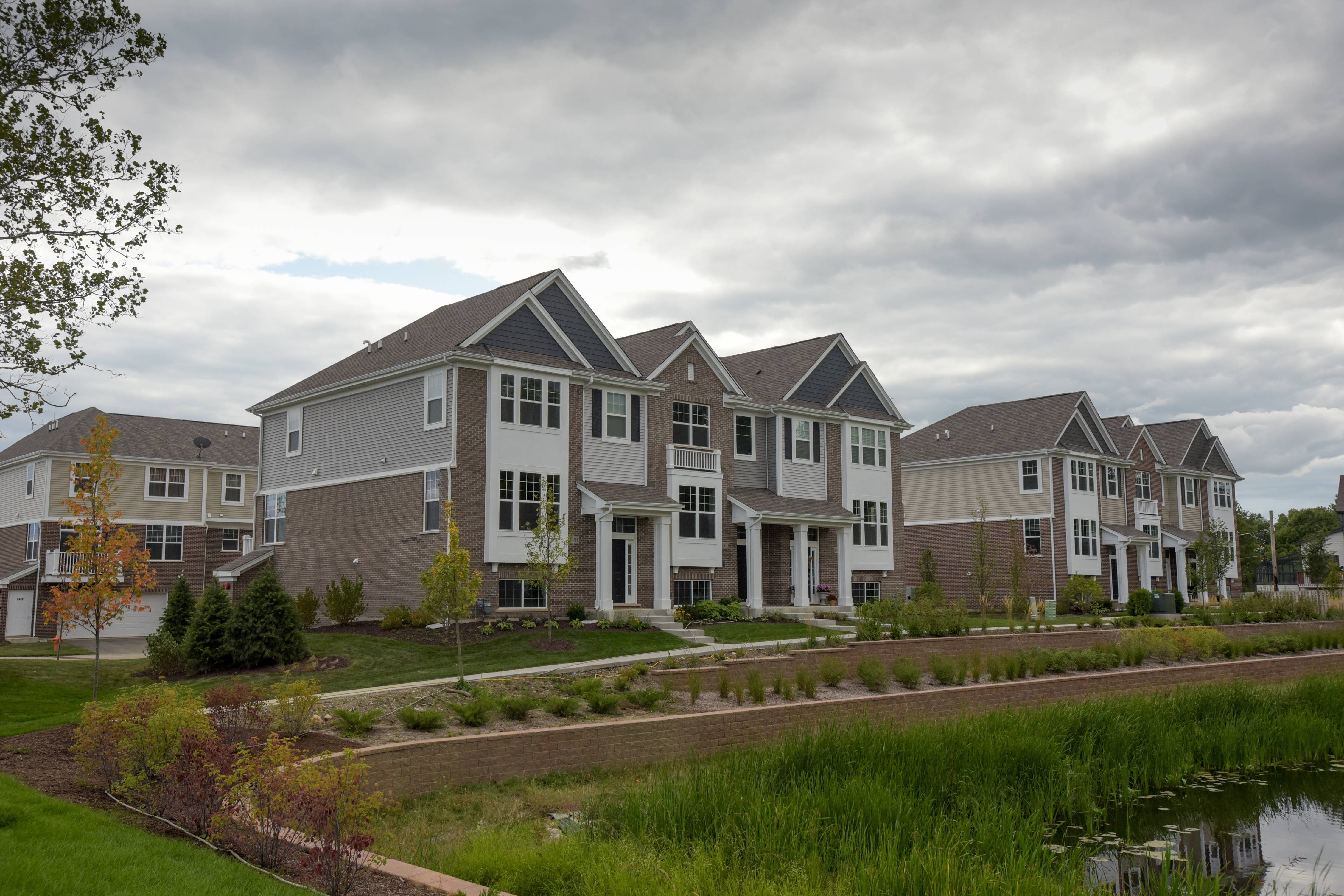 The Bauer Place development north of Ogden Avenue in Naperville includes 28 townhouses that are built or under construction, and a third phase approved this week will add nine more units.