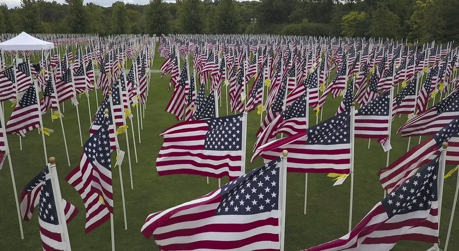 The main observance at the Healing Field begins at 11 a.m. Sunday with the reading of the names of the fallen.