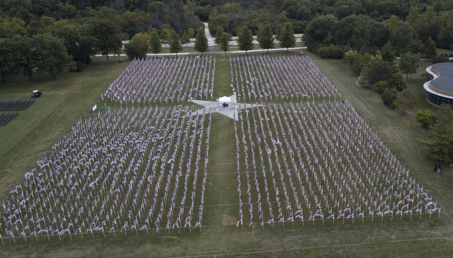 """When you tell people that 2,976 died, that's just a number,"" Jerry Christopherson, president of True Patriots Care, said Thursday. ""When you see about two acres of flags and realize that every one was a person, that kind of brings it into perspective."""