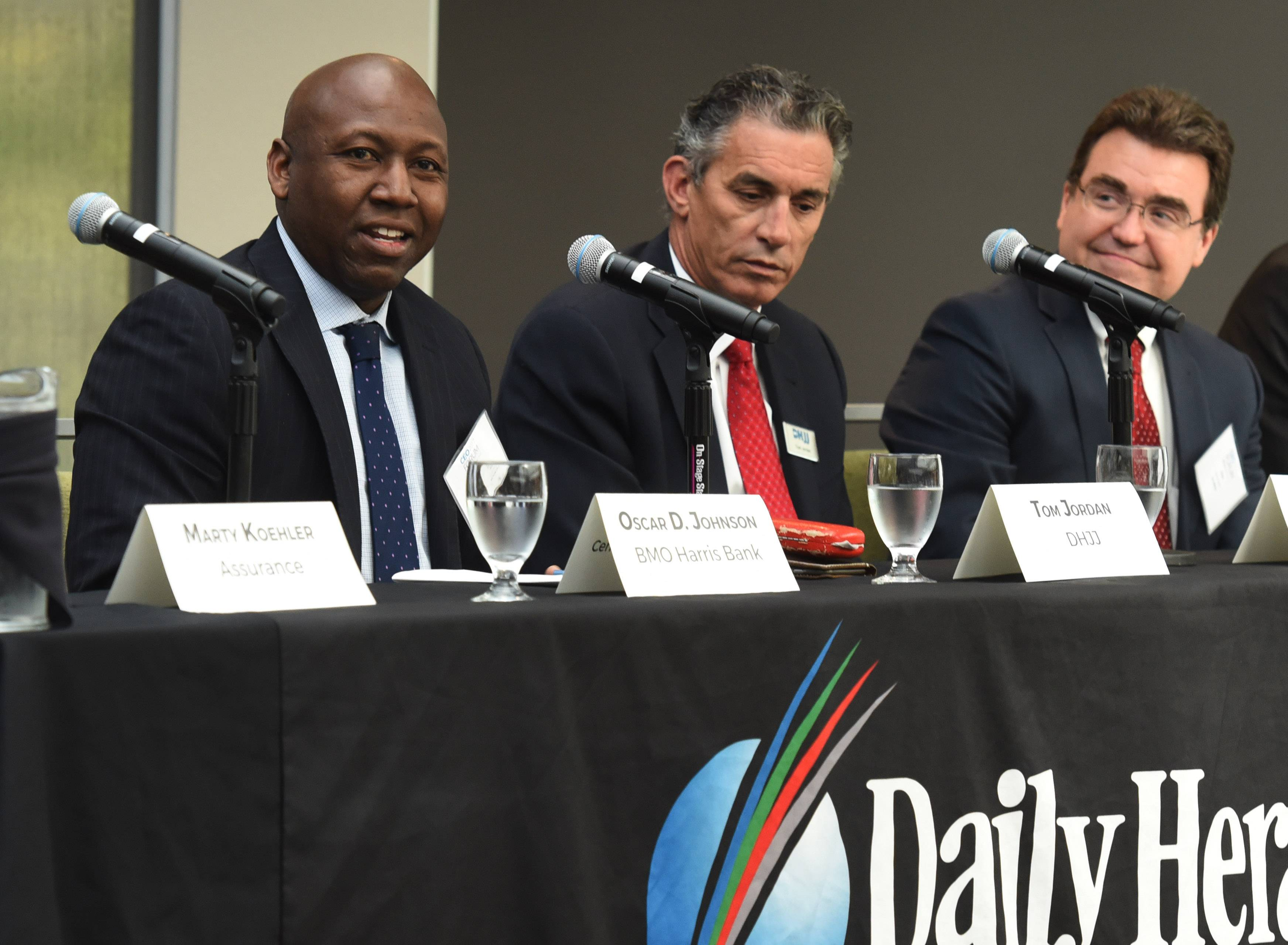 Panelist Oscar Johnson, left, of BMO Harris Bank speaks during the 2017 CEO Forum by the Daily Herald and Daily Herald Business Ledger.
