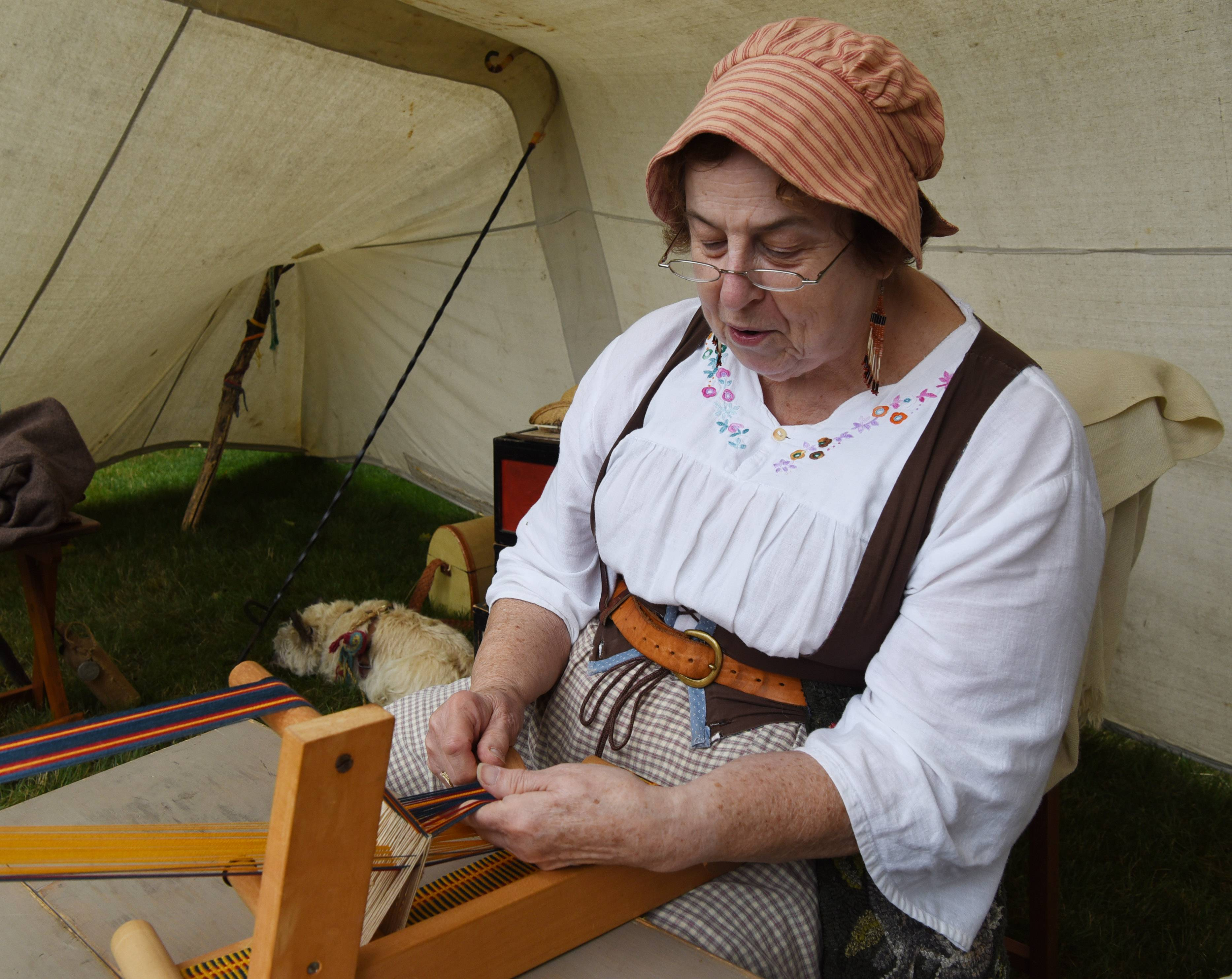 Diane Mate of Arlington Heights, a member of the Du Page Valley Settlers, works with an inkle loom during last year's Bartlett Heritage Days celebration Saturday. The group is returning to this year's festival.