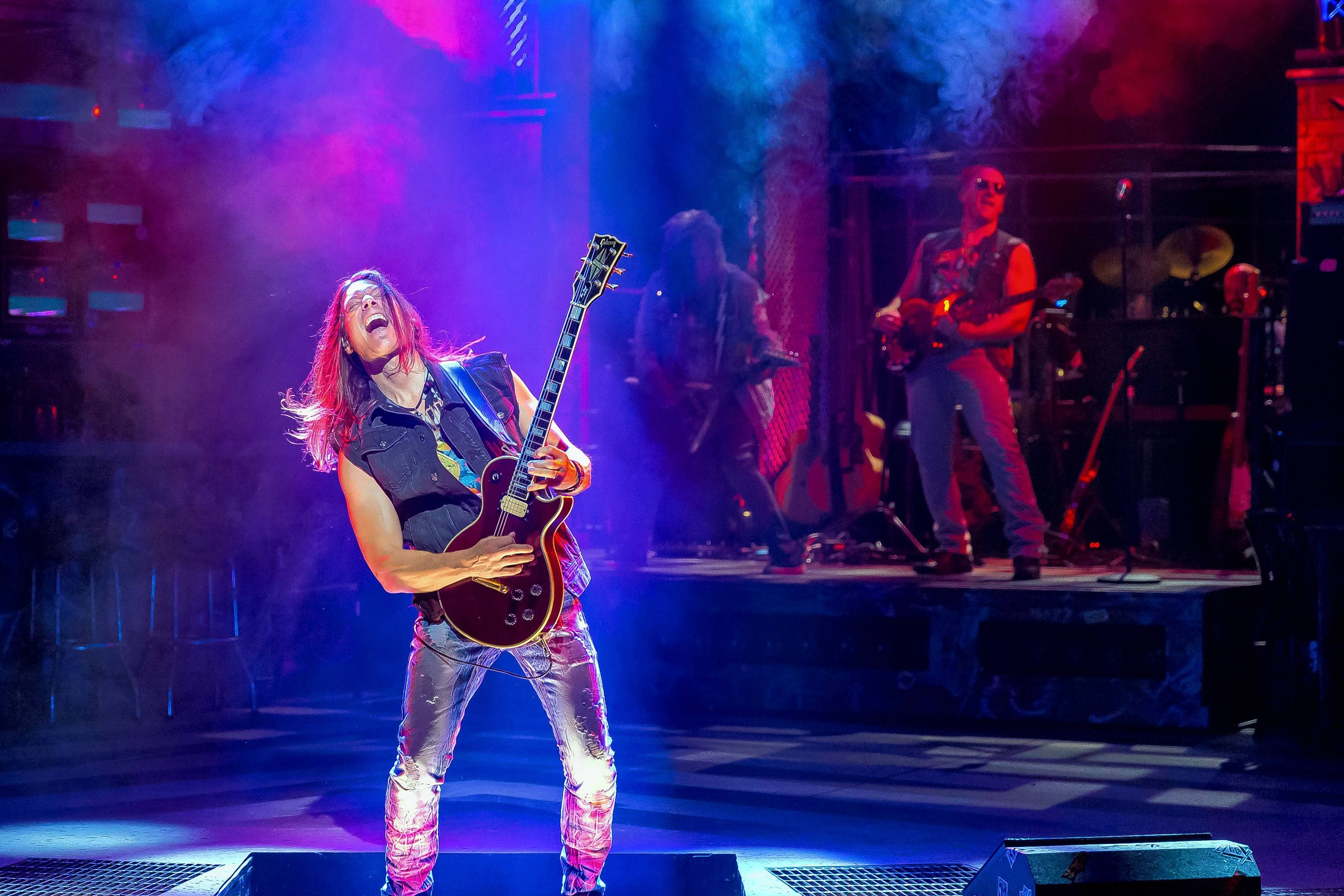 "Guitarist Dan Peters launches the opening medley of 1980s hits in ""Rock of Ages"" at Drury Lane Theatre in Oakbrook Terrace."