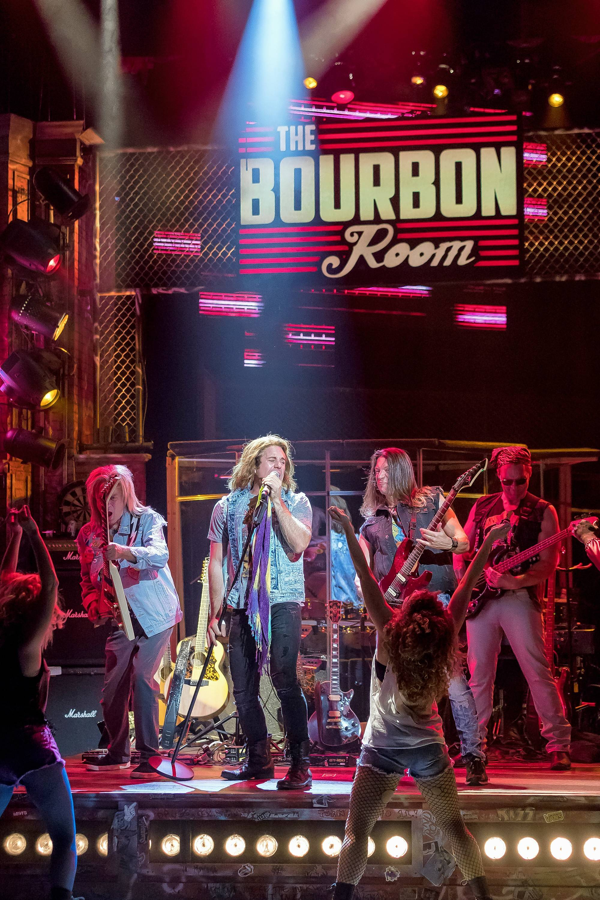 "Drew (Russell Mernagh) gets the chance to be an opening act for a headlining band at The Bourbon Room in ""Rock of Ages"" at Drury Lane Theatre in Oakbrook Terrace."