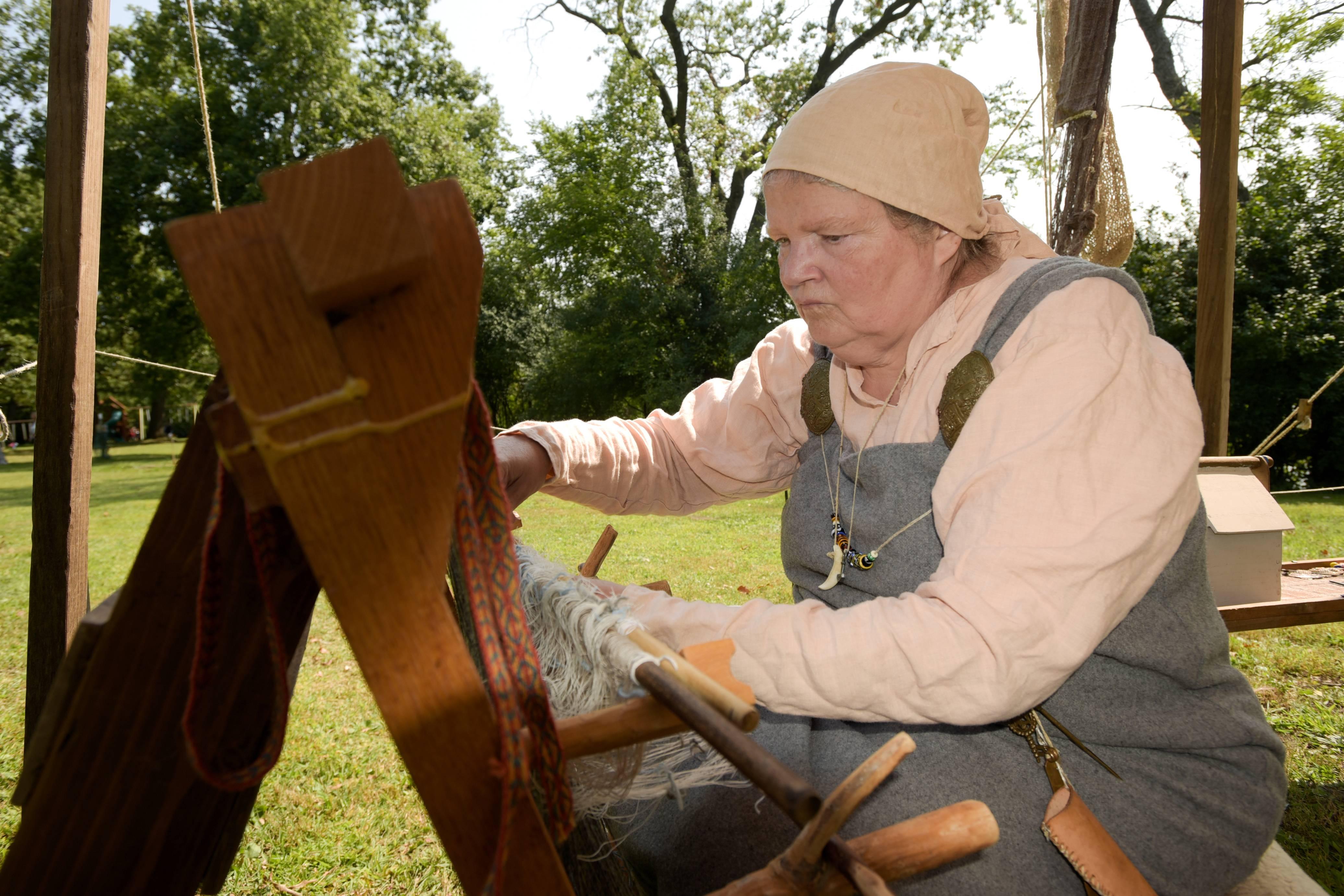 Julia Watkins of Urbana demonstrates early Anglo-Scandinavian weaving during the 38th Annual Scandinavian Day Festival Sunday in South Elgin. Visitors were treated to sunny weather to enjoy Scandinavian entertainment, food and activities. The group Kyle and Dave performed an eclectic blend of traditional and modern Norwegian folk music, to the joy of the audience. Younger visitors could ride horses and ponies in the South Elgin park along the Fox River or create their own personalized Viking shields. The festival celebrated five countries -- Denmark, Norway, Sweden, Finland and Iceland.
