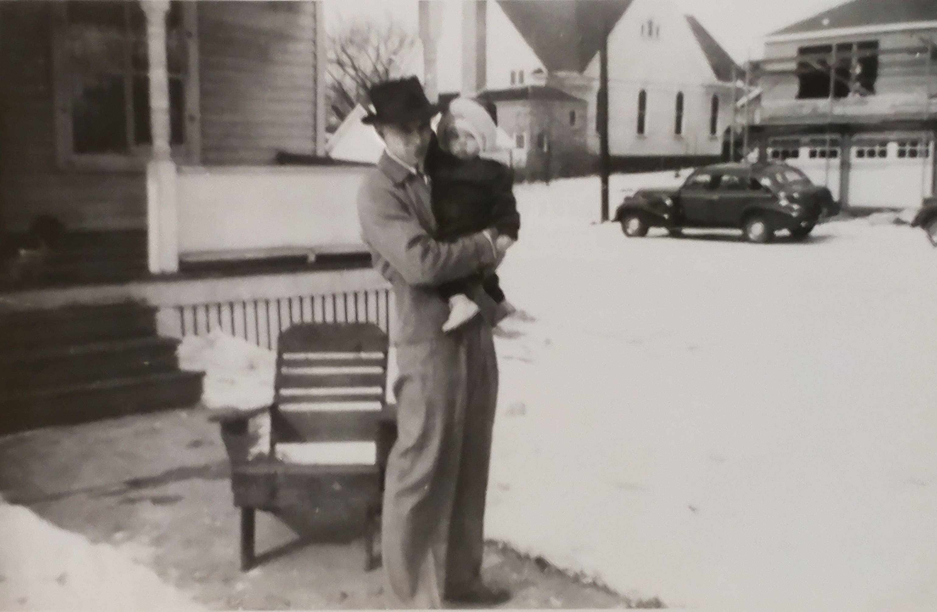 Mel Schroeder, 94, holds his daughter, Linda, in front of his childhood house at 118 Wool St. in Barrington in this 1949 photograph. He plans to watch as the house is moved Sunday down Main Street west to Barrington Hills.