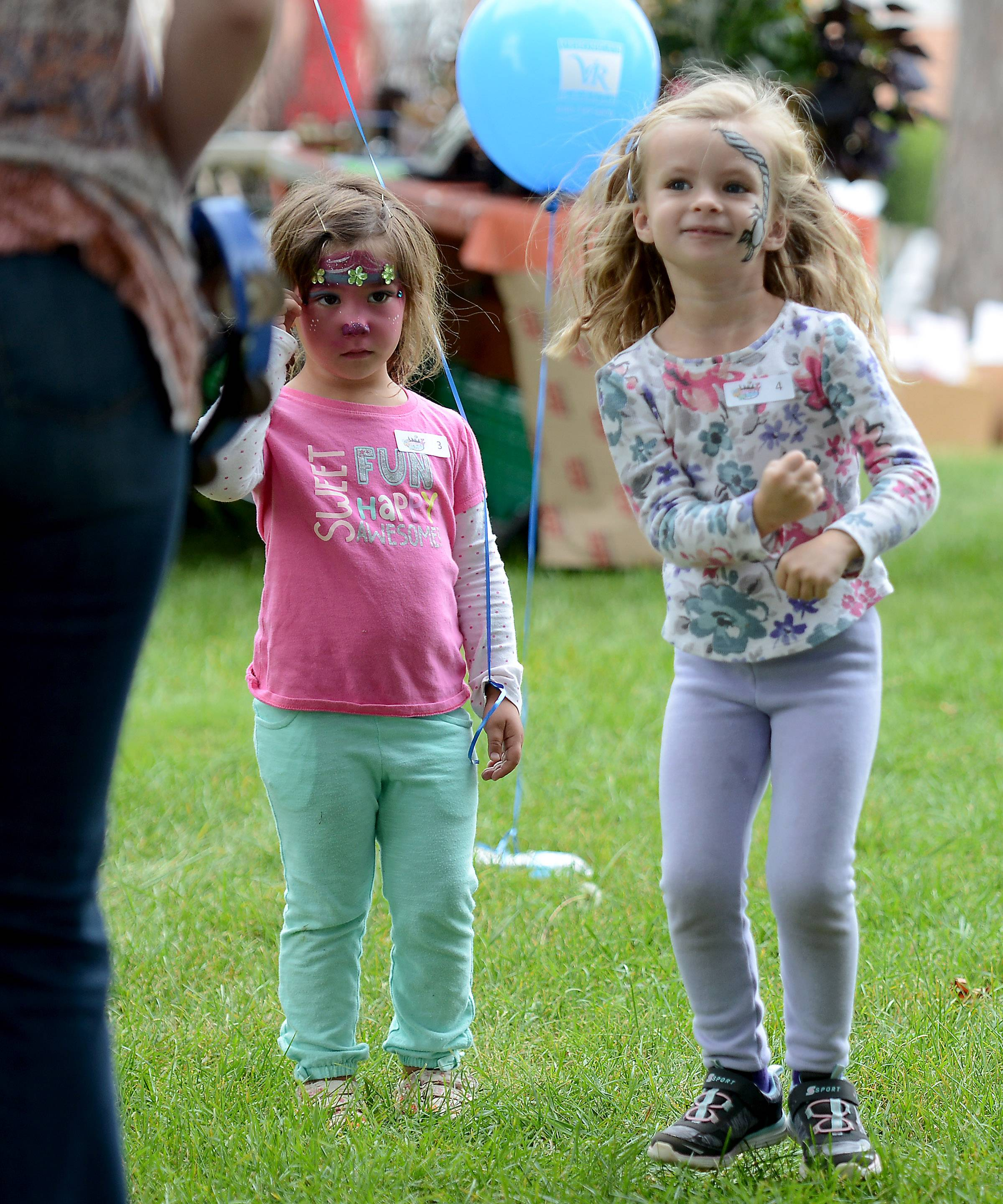 Lilly Gemmell, right, 4, of St. Charles moves to the beat of The Thompson Duo while her friend Olivia Dazzo, 3, of Geneva watches her moves during day one of Festival of the Vine Friday in Geneva.