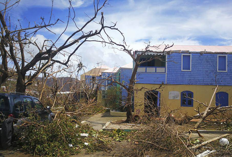 This photo provided on Friday, Sept. 8, 2017 shows storm damage in the aftermath of Hurricane Irma in Tortola, in the British Virgin Islands. Irma scraped Cuba's northern coast Friday on a course toward Florida, leaving in its wake a ravaged string of Caribbean resort islands strewn with splintered lumber, corrugated metal and broken concrete. (Jalon Manson Shortte via AP)