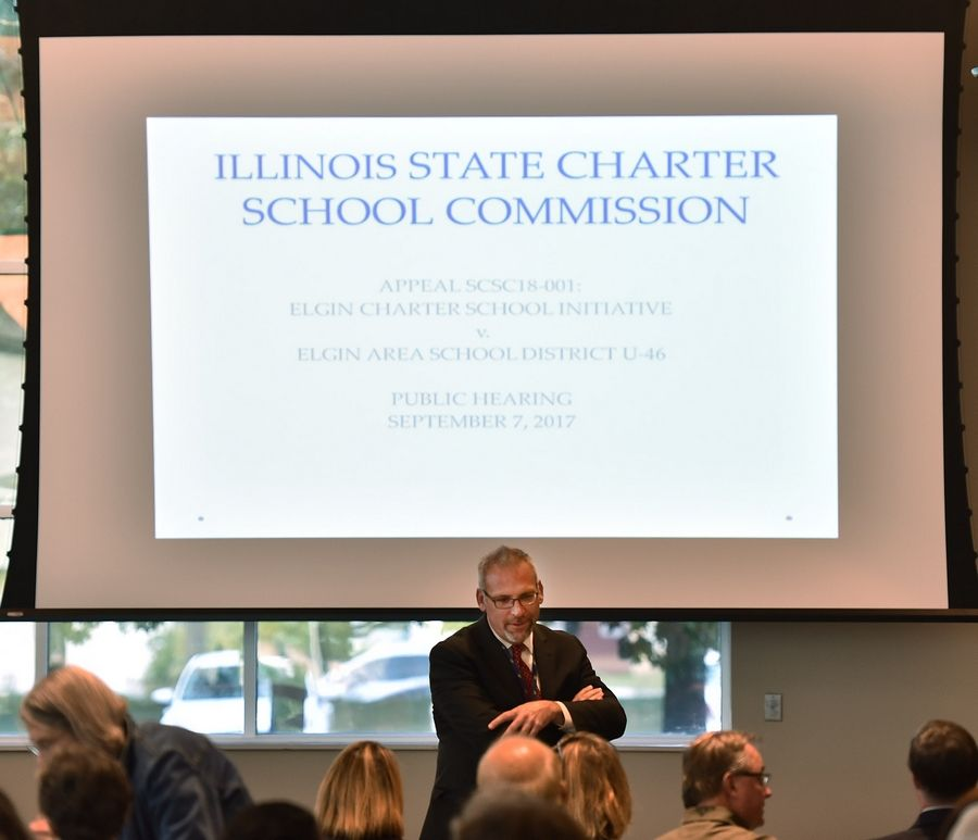 U-46 CEO Tony Sanders talks Thursday with those attending a public hearing on the potential development of a charter school in Elgin.
