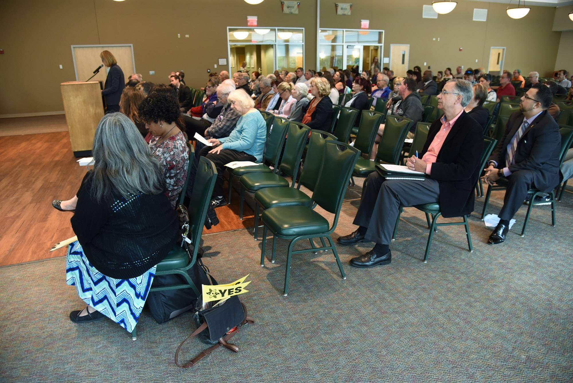 The crowd listens at a public hearing Thursday on the potential development of a charter school in Elgin.