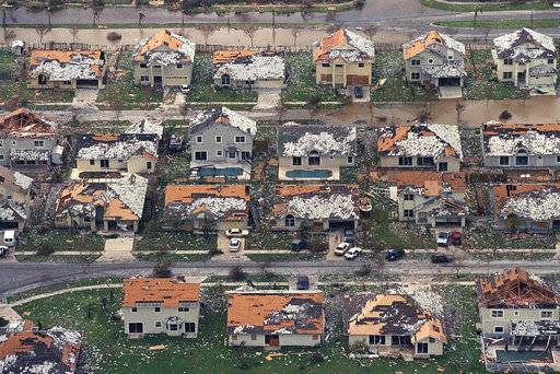 FILE — In this Aug. 25, 1992, file photo, rows of damaged houses sit between Homestead and Florida City, Fla., after Hurricane Andrew struck. After a catastrophic Hurricane Andrew revealed how lax building codes had become in the country's most storm-prone state, Florida began requiring sturdier construction. Now, experts say a monstrously strong Hurricane Irma could become the most serious test of Florida's storm-worthiness since the 1992 disaster. (AP Photo/Mark Foley, File) The Associated Press