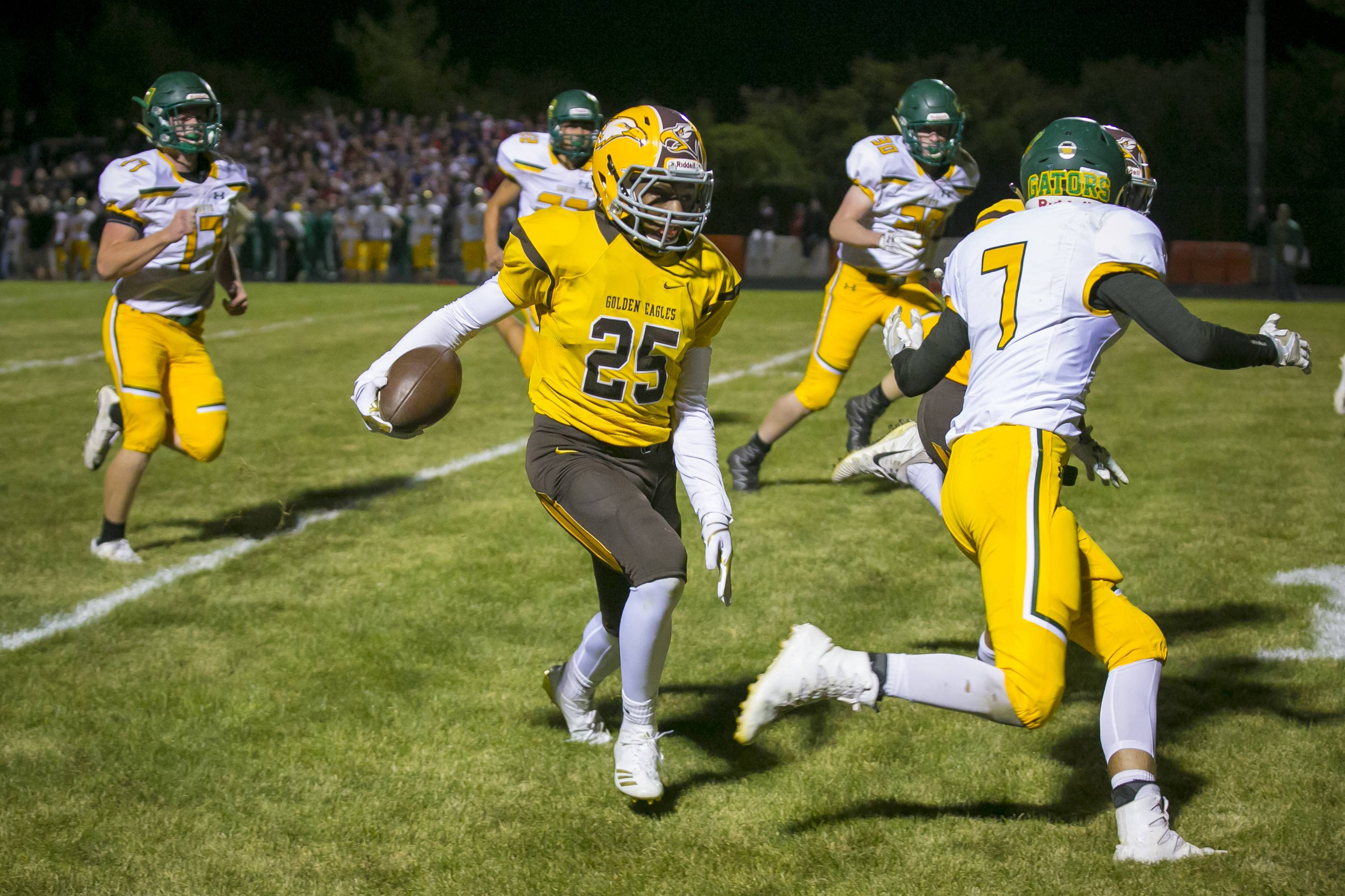 Jacobs defensive back Jukauri Bland (25) jukes past Crystal Lake South's Blake Kuffel (7) for a touchdown Friday.
