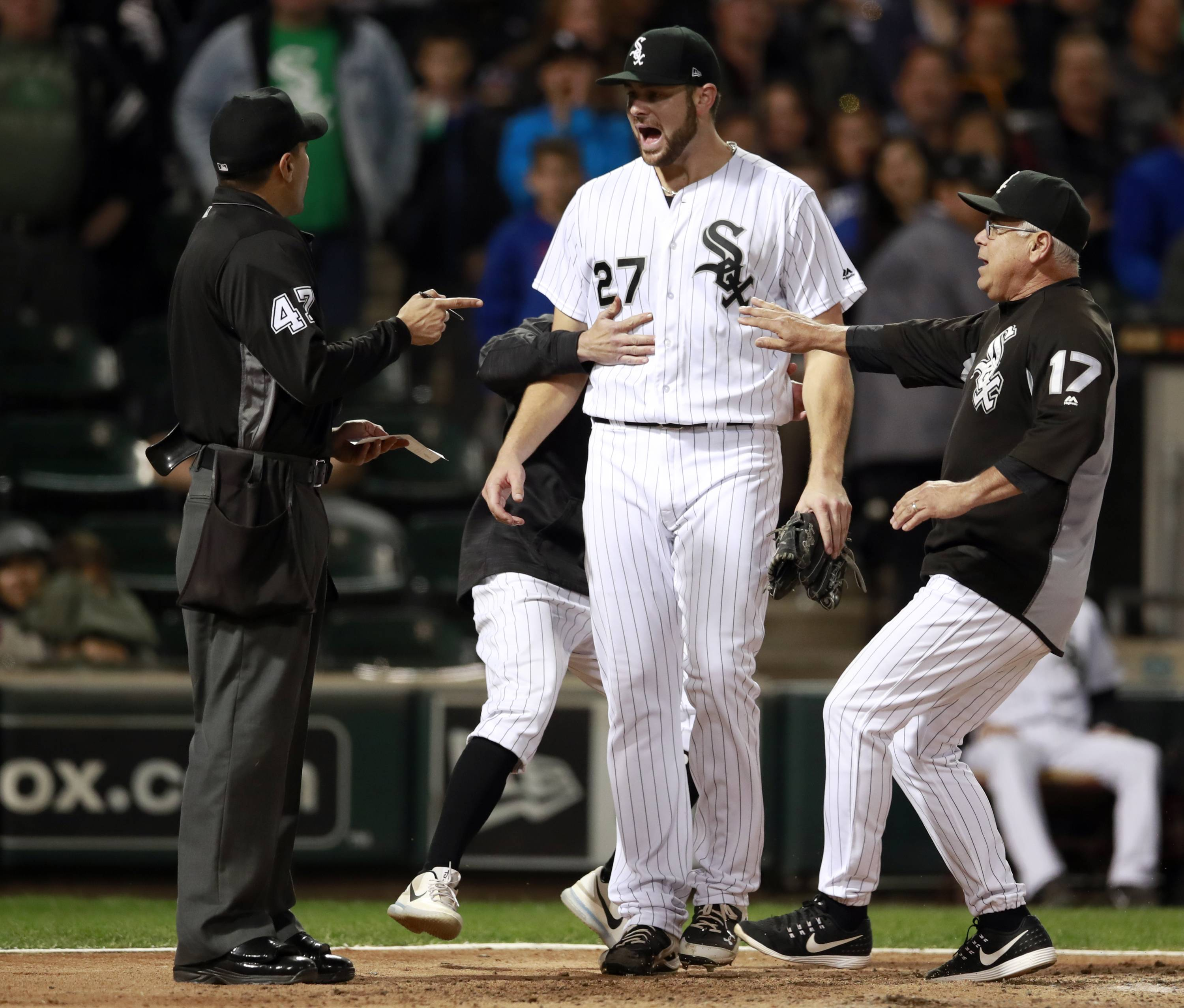 White Sox starting pitcher Lucas Giolito (27) argues with umpire Gabe Morales (47) as manager Rick Renteria (17) holds him back after being thrown out of a baseball game by Morales during the sixth inning against the San Francisco Giants in Chicago, on Friday, It was a tough night for the White Sox, who lost to the San Francisco Giants 9-2 Friday at Guaranteed Rate Field.