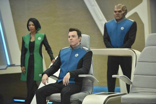 "This image released by Fox shows, from left, Penny Johnson Jerald, Seth MacFarlane and Peter Macon in a scene from ""The Orville,"" premiering Sept. 10, on Fox. (Michael Becker/Fox via AP)"