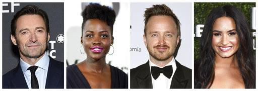 This combination photo shows, from left, Hugh Jackman, Lupita Nyong'o, Aaron Paul and Demi Lovato who will co-host this year's Global Citizen Festival, an annual free event held in New York's Central Park on Sept. 23. (AP Photo/File)