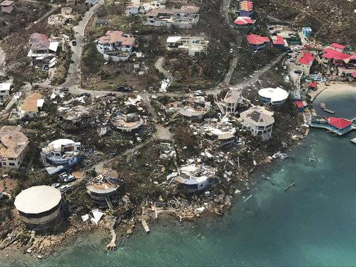 This photo provided by Caribbean Buzz shows the destruction left in the wake of Hurricane Irma Friday, Sept. 8, 2017, in the U.S. Virgin Islands The death toll from Hurricane Irma has risen to 22 as the storm continues its destructive path through the Caribbean. The dead include 11 on St. Martin and St. Barts, four in the U.S. Virgin Islands and four in the British Virgin Islands. There was also one each in Barbuda, Anguilla, and Barbados. The toll is expected to rise as rescuers reach some of the hardest-hit areas. (Caribbean Buzz via AP)