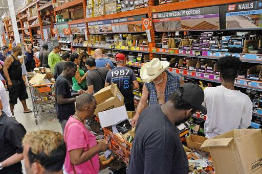 Customers at a Home Depot in South Miami Dade buy building materials to secure their property in anticipation of Hurricane Irma early Friday, Sept. 8, 2017 in Miami, Fla. The National Hurricane Center says Hurricane Irma weakened a bit more but remains a powerful threat to Florida.