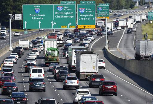 Heavy traffic traveling north bound on Interstate 75 moves slowly, as a major evacuation has begun in preparation for Hurricane Irma, Friday, Sept. 8, 2017, in Forrest Park, south of Atlanta.