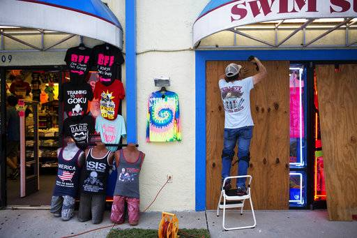 Jone Yoon boards up his beach souvenir shop ahead of Hurricane Irma in Daytona Beach, Fla., Thursday, Sept. 7, 2017. South Florida officials are expanding evacuation orders as Hurricane Irma approaches, telling more than a half-million people to seek safety inland.