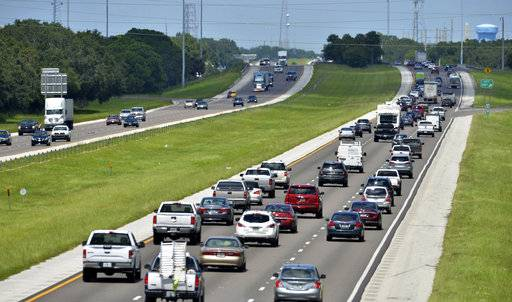 Northbound traffic, right, on I-75 through Sarasota, Fla., is heavier than normal, but still moving on Thursday, Sept. 7, 2017. Many South Florida residents are evacuating and heading north as Hurricane Irma approaches. (Mike Lang /Sarasota Herald-Tribune via AP)