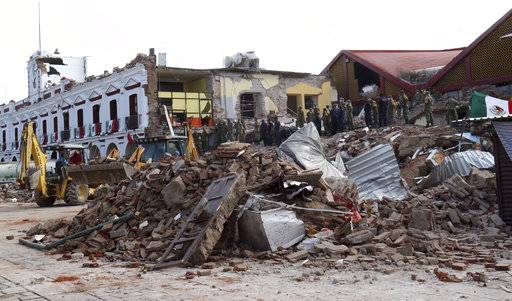 Soldiers remove debris from a partly collapsed municipal building after an earthquake in Juchitan, Oaxaca state, Mexico, Friday, Sept. 8, 2017. One of the most powerful earthquakes ever to strike Mexico has hit off its southern Pacific coast, killing at least 32 people, toppling houses, government offices and businesses. With multiple intense hurricanes, a powerful earthquake, wildfires and deadly flooding from Houston to India it seems that nature recently has just gone nuts. Some of these disasters, like Friday's earthquake in Mexico, are natural. Others may end up having a mix of natural and man-made ingredients after scientists examine them. Experts in risk and psychology said we look for patterns in overwhelming things like disasters. Sometimes there's a pattern in chaos. Sometimes there isn't. (AP Photo/Luis Alberto Cruz)