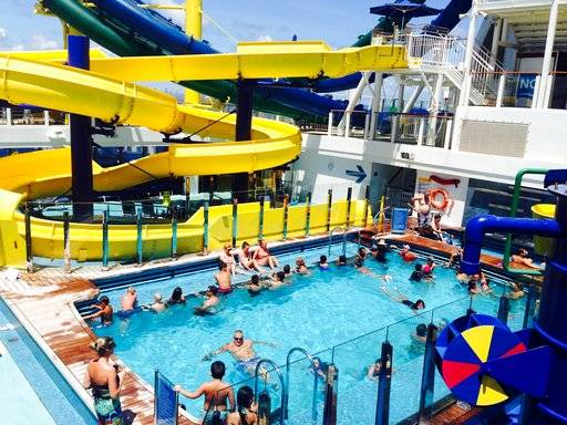 In this Thursday, Sept. 7, 2017 photo, passengers aboard the Norwegian Escape cruise ship relax in a pool just hours before the huge vessel returned to Miami, two days earlier than scheduled due to powerful Hurricane Irma. Some passengers disembarked Thursday, while others chose to remain on board the ship, which was scheduled to leave later that evening for safe waters. (AP Photo/Brian Witte)