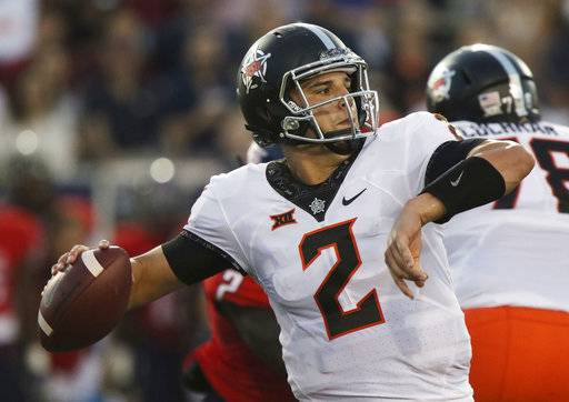 Oklahoma State quarterback Mason Rudolph looks to throw against South Alabama during the first half of an NCAA college football game, Friday, Sept. 8, 2017, in Mobile, Ala. (AP Photo/Dan Anderson)