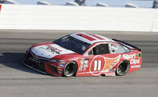 Denny Hamlin drives in Turn 1 during a NASCAR Monster Cup auto race at Darlington Raceway, Sunday, Sept. 3, 2017, in Darlington, S.C. (AP Photo/Terry Renna)