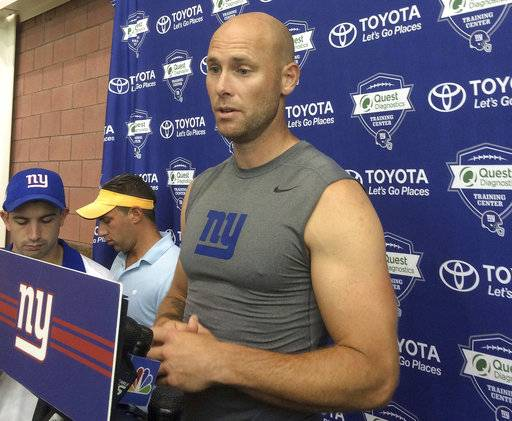FILE - In this Aug. 18, 2016, file photo, New York Giants' Josh Brown speaks with reporters at NFL football teams training camp in East Rutherford, N.J. The NFL suspended former New York Giants kicker and current free agent Josh Brown for six games, a person familiar told The Associated Press on Friday, Sept. 8, 2017. The decision to extend the ban follows a league review of Brown's repeated abuse of his former wife while they were married. The person spoke on condition of anonymity because the NFL had not released its ruling. (AP Photo/Tom Canavan, File)