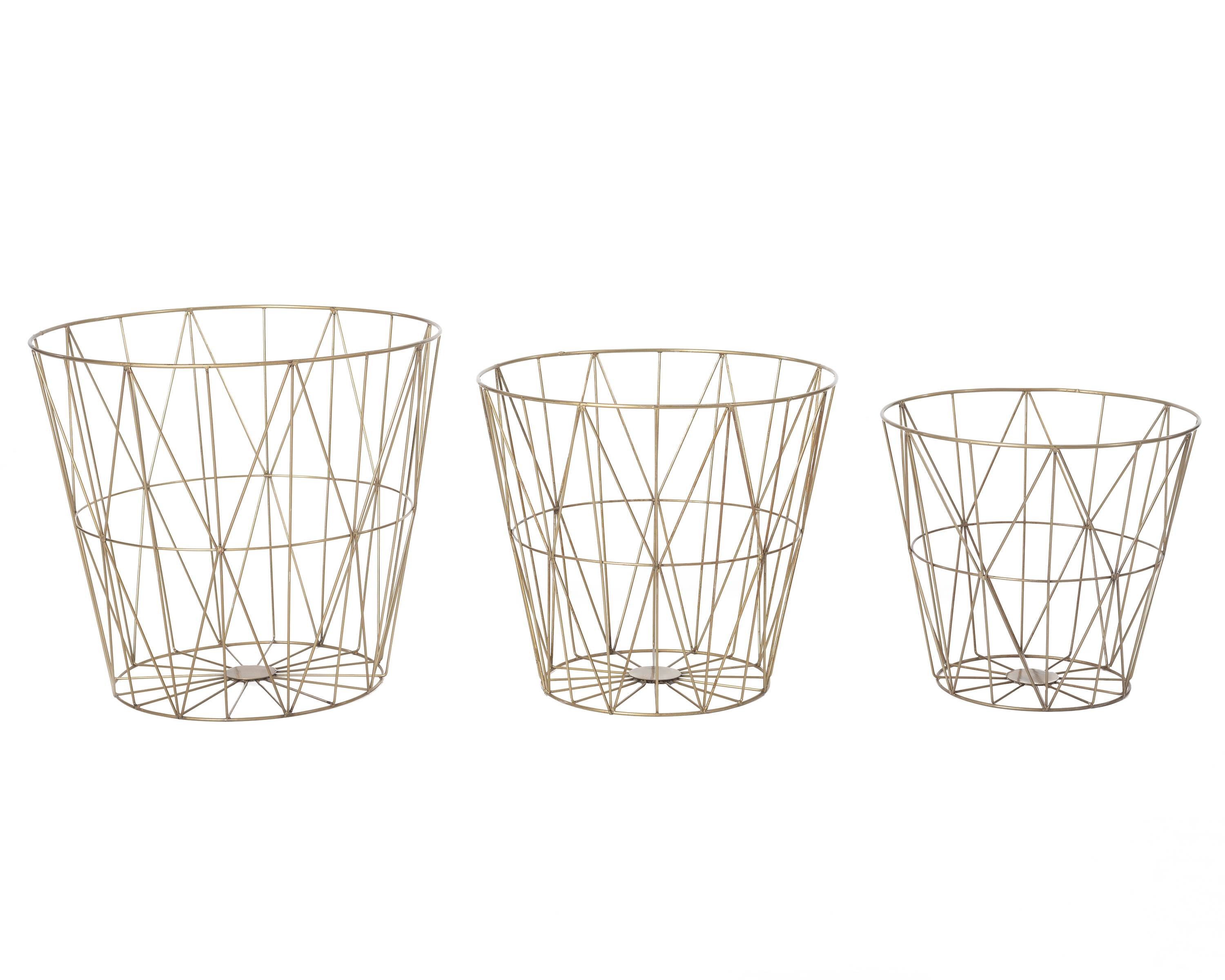 Designer Annie Selke's wire basket sets at Pine Cone Hill, which bring several trends into a room, including brass accents, minimalism and geo patterning. While they make handy trash bins, they can also be used as decorative storage.
