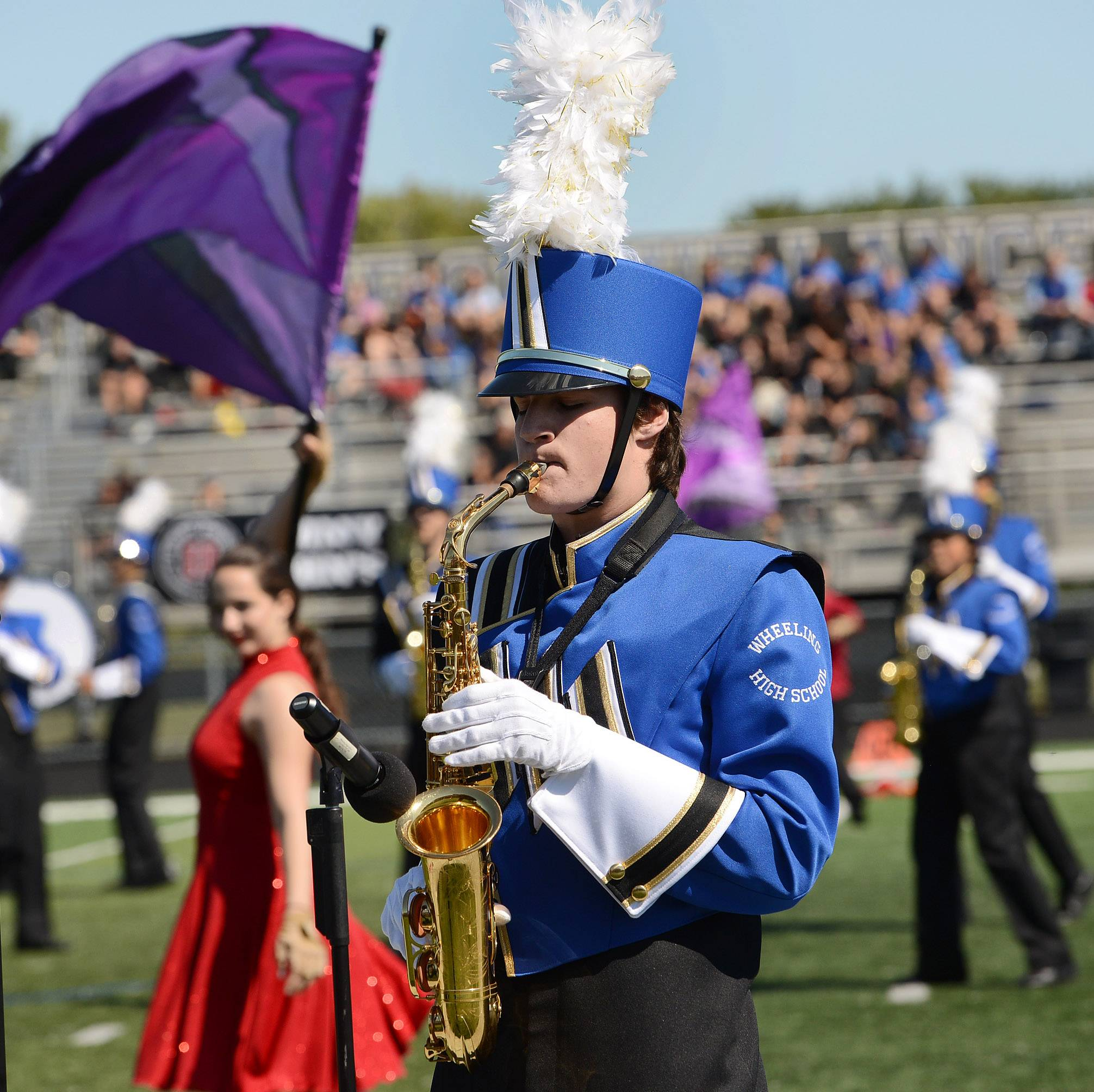 Wheeling Marching Band member Jon Musto plays the saxophone Saturday at the 39th annual Lake Park Lancer Joust.