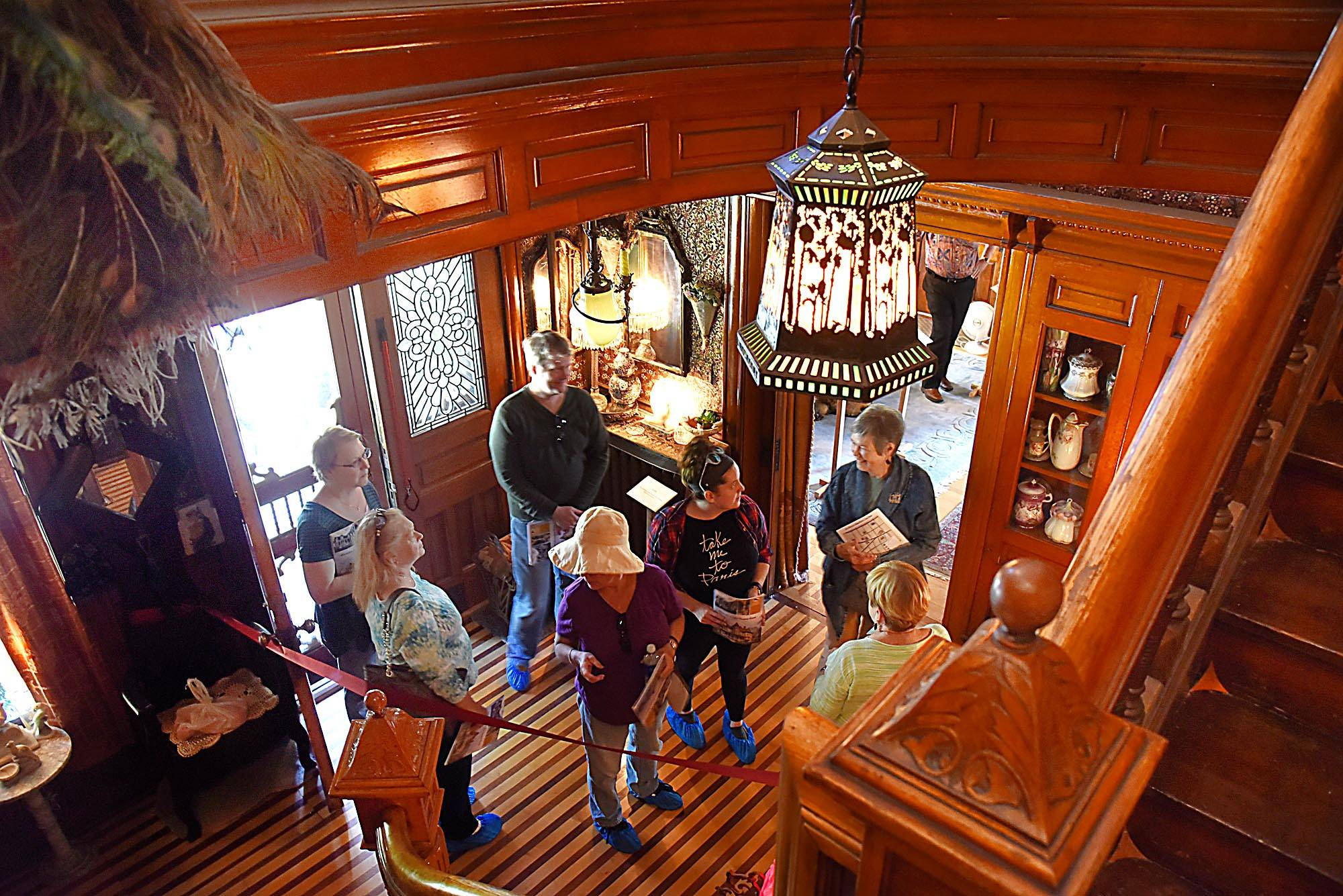 Visitors enter the Wing Manshion during the Historic Elgin House Tour Saturday on Highland Avenue in Elgin.
