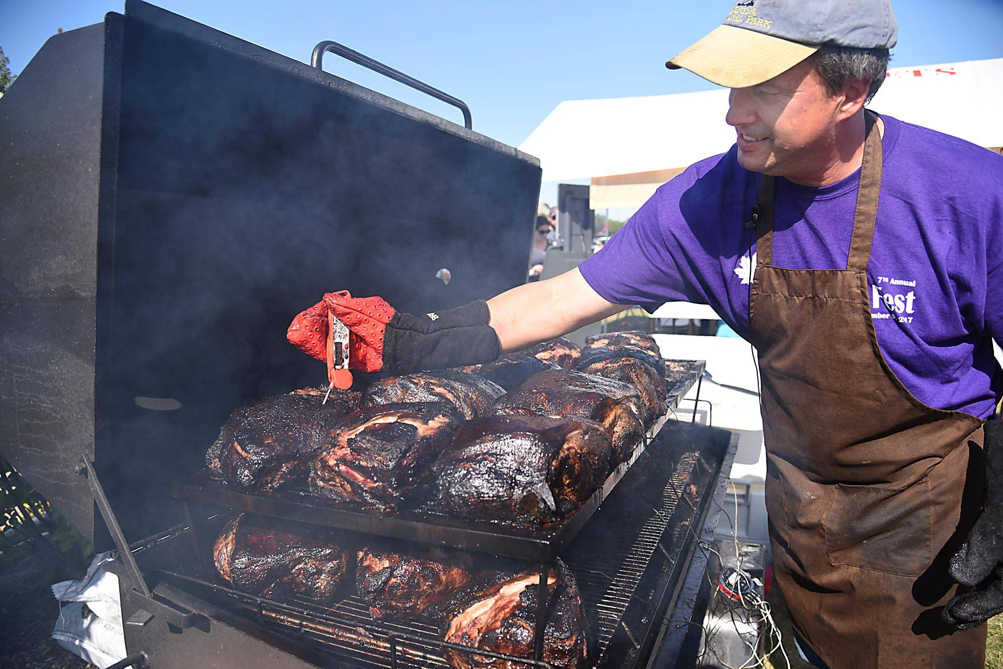 Dave Schopen checks the temperature on dozens of beef roasts Saturday at the United Fall Festival in Campton Hills. He said he started roasting about 700 pounds of meat at 4 a.m.