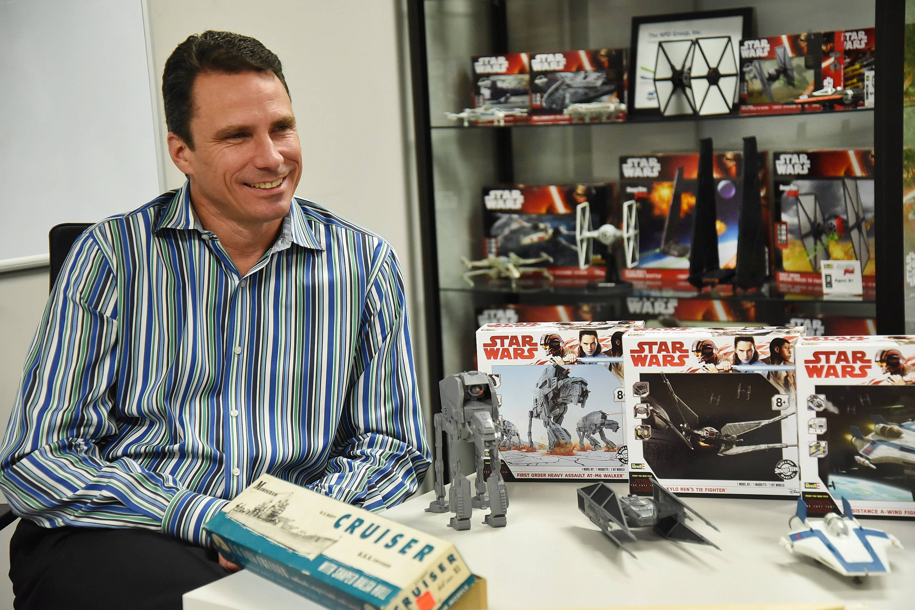 "Sitting at a table with Revell models that include a boat made from balsa wood and the latest ""Star Wars"" fighters, Lou Aguilera, vice president and general manager of Revell, says the Elk Grove Village model-maker had to evolve to stay relevant in the modern world."
