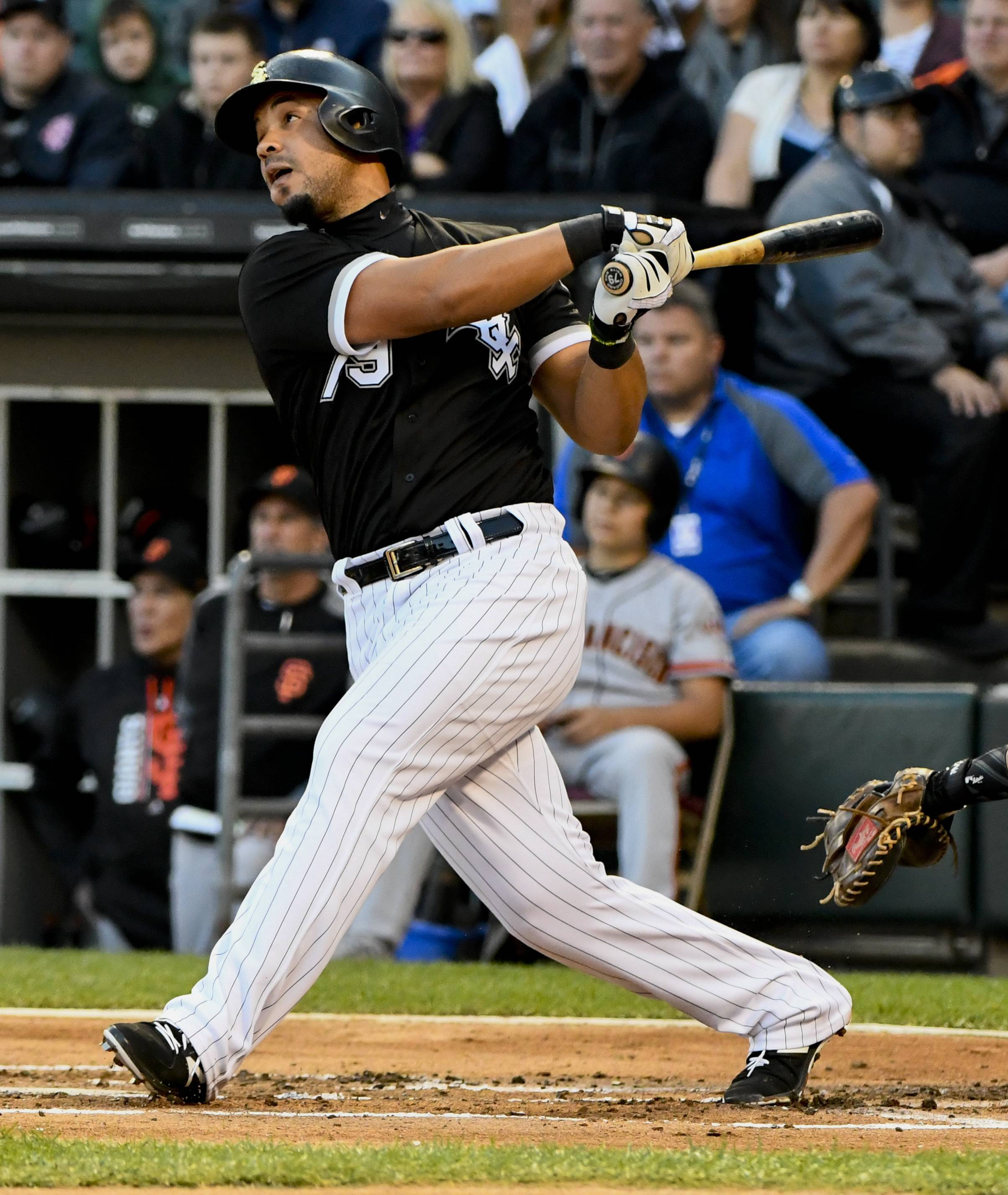 Chicago White Sox's Jose Abreu watches his solo home run against the San Francisco Giants during the first inning of a baseball game in Chicago on Saturday, Sept. 9, 2017. (AP Photo/Matt Marton)