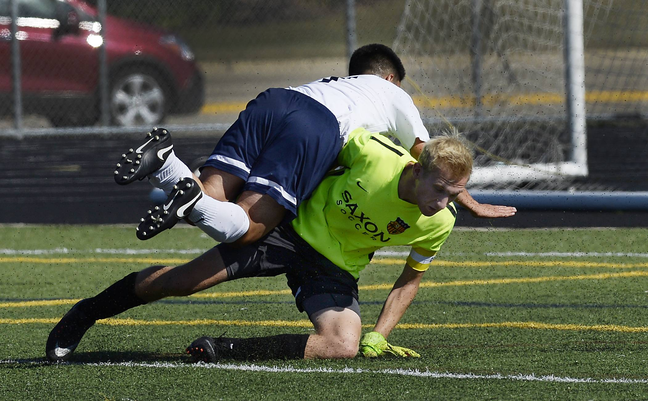 Conant's Eduardo Dorado and Schaumburg goalie Grant Behrens collide, which resulted in Behrens leaving the game at Conant on Saturday.