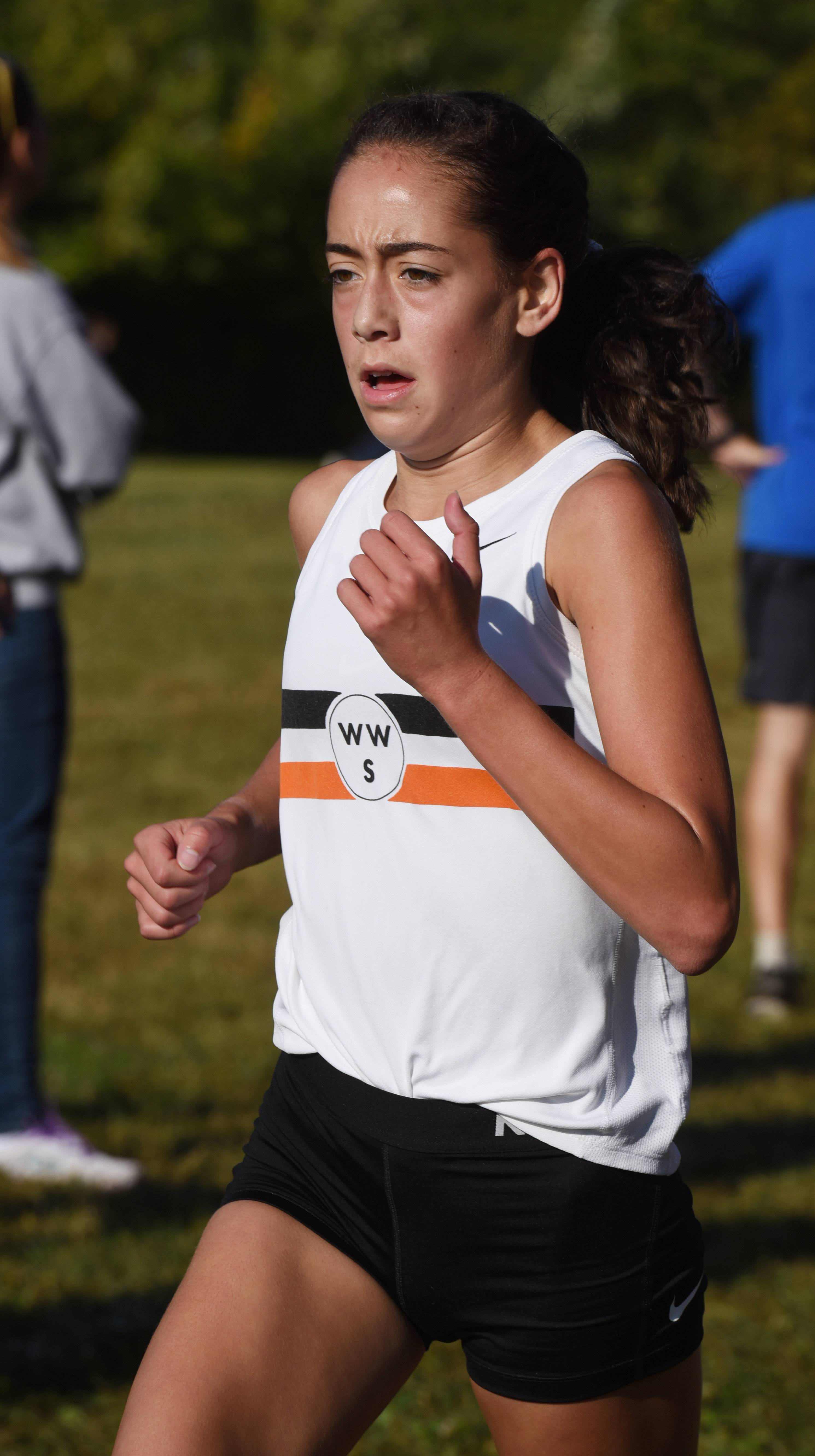 Wheaton Warrenville South's Maria Rucoba wins the Wauconda cross-country invite at Matthews Middle School in Island Lake Saturday.
