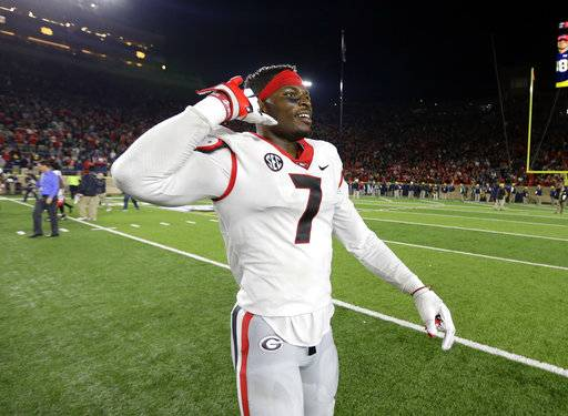 Georgia linebacker Lorenzo Carter celebrates following the team's 20-19 win over Notre Dame in an NCAA college football game in South Bend, Ind., Saturday, Sept. 9, 2017. (AP Photo/Michael Conroy)