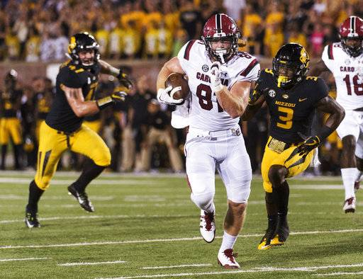 South Carolina tight end Hayden Hurst, center, runs past Missouri's Ronnell Perkins, right, and Cale Garrett, left, as he scores a touchdown during the third quarter of an NCAA college football game, Saturday, Sept. 9, 2017, in Columbia, Mo. (AP Photo/L.G. Patterson)