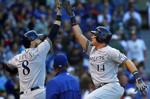 Milwaukee Brewers' Hernan Perez, right, celebrates his home run against the Chicago Cubs with teammate Ryan Braun during the fifth inning of a baseball game, Saturday, Sept. 9, 2017, in Chicago. (AP Photo/Jim Young)