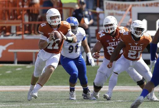 Texas quarterback Sam Ehlinger (11) looks to throw as he tuns against San Jose State during the first half of an NCAA college football game, Saturday, Sept. 9, 2017, in Austin, Texas. (AP Photo/Eric Gay)